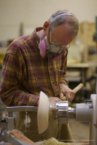 scraping a wooden bowl on the lathe